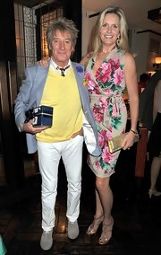 Penny Lancaster carried a metallic clutch at Johnny Gold's birthday party.