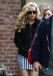 Kate sported voluminous blonde curls while on set for her new movie.