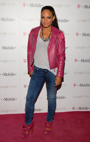 Christina Milian added a girlish twist to her look, opting for a bright pink leather jacket and matching heels.