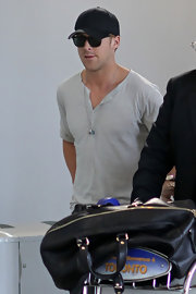 Ryan Gosling hid his shiny blonde locks underneath a plain black baseball cap.