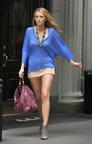Blake Lively paired her cobalt tunic with a gemstone statement neckalce.