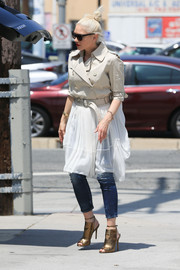 Gwen Stefani was her usual funky self in gold peep-toe booties, cropped jeans, and a sheer-bottom trenchcoat while out and about.