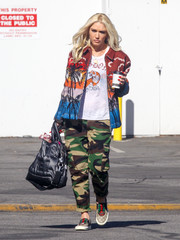 Gwen Stefani cut a colorful figure in a palm-print bomber jacket by No. 21 while out in LA.