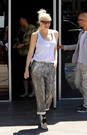 Gwen Stefani styled a plain white tank top with snakeskin-print pants.