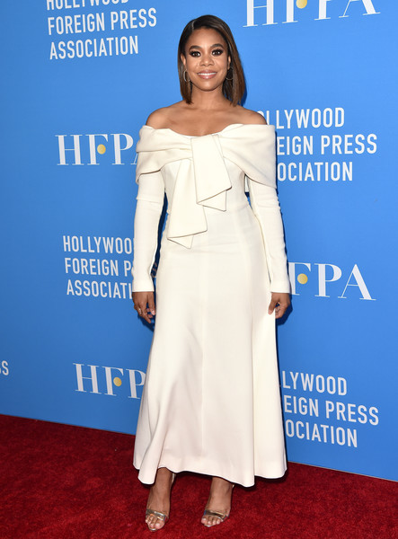 Regina Hall cut a chic figure in a white off-the-shoulder maxi dress by Lela Rose at the 2019 HFPA Grants Banquet.