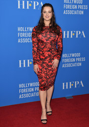 Katherine Langford sheathed her figure in a form-fitting red print dress by Givenchy for the HFPA Grants Banquet.