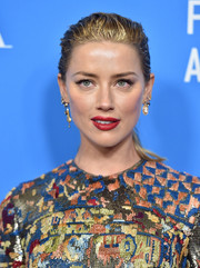 Amber Heard went for a casual wet-look ponytail at the HFPA Grants Banquet.