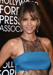 Halle Berry styled her hair into a messy updo with wispy bangs for the HFPA Grants Banquet.