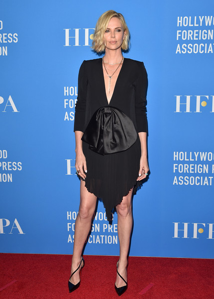 Charlize Theron complemented her dress with black diagonal-strap pumps by Christian Louboutin.