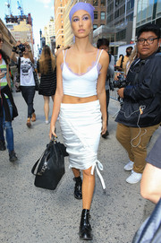 Hailey Baldwin put her cleavage and abs on display in a cropped cami by Are You Am I while out and about.