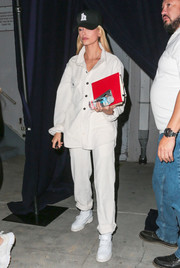 Hailey Baldwin matched her top with a pair of white pants.