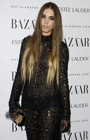 Amber Le Bon carried a uniquely shaped purse at the Harper's Bazaar Women of the Year Awards.