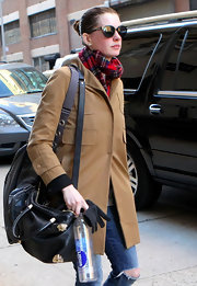 Anne Hathaway looked wintery in a red tartan flannel scarf while out in Chelsea.