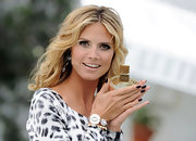 Heidi Klum wore a deep aubergine nail polish when launching her new fragrance Shine. To try her look, we recommend a nail polish like OPI Nail Colour in Caffeine Fix