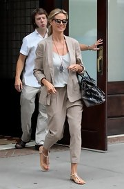 Heidi opted for a totally light and airy look with this tan pantsuit that featured a pair of harem pants.