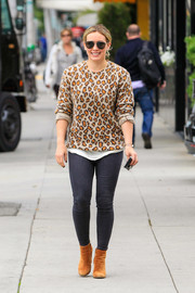 Hilary Duff cut a tough-chic figure in a leopard-print sweater teamed with skinny jeans while out and about.