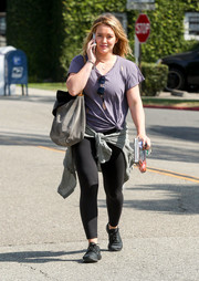 Hilary Duff headed out sporting a tattered purple tee and black leggings.