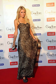 Paris Hilton accented her exotic leopard print gown with an ombre hard case clutch.