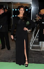 Lucy Pinder wore simple black platform sandals teamed with an elegant column dress when she attended the premiere of 'The Hobbit: An Unexpected Journey.'