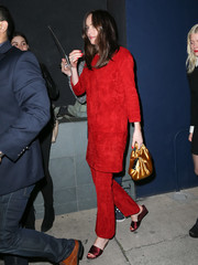 Dakota Johnson styled her outfit with purple satin wedges by Jimmy Choo.