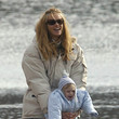 Elle MacPherson and her Bundled Baby