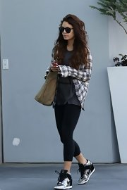 A plaid button down paired over a graphic tee topped off Vanessa Hudgens' casual gym look.