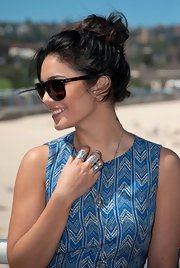 Vanessa Hudgens wore her hair in a loose bun while posing on the beach.