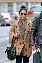 Vanessa Hudgens wore this playful heart-shaped aviators while out in Soho with her boyfriend.