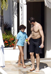 Oscar Jackman wore a powder blue rash guard as he took a dip in the hotel pool.