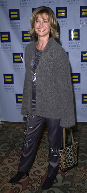Olivia Newton-John carried a leopard print open tote at the Human Rights Campaign Gala.