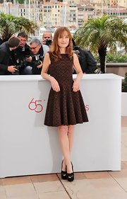 Isabelle Huppert wore multi-textured black platform peep-toes with her dress for a sophisticated finish.