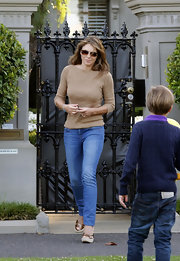 Elizabeth Hurley got a boost from a pair of summery bronze espadrille wedges.