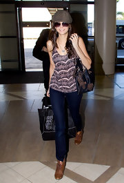 Nina Dobrev kept her travel style feminine with a sweet lace tank.