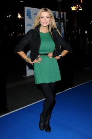 Nicola McLean completed her premiere night look with a pair of studded ankle boots.