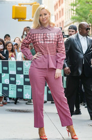 Iggy Azalea covered up her curves in a long-sleeve mixed-print blouse for her visit to Build.