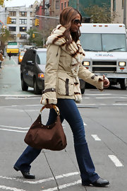 Iman was out and about NYC in a chic beige jacket paired with dark jeans. She accessorized the ensemble with a brown suede purse complete with gold hardware.