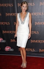 Claire Holt chose a ruched white dress with a silver disc-embellished V-neck.