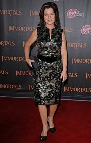 Marcia Gay Harden matched her elegant outfit with a black satin purse at the movie premiere.