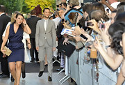 Joseph steps onto the red carpet in a dove gray single-breasted suit.