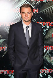 Leonardo paired his navy blue suit with a silver solid tie.