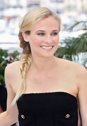 Diane looks youthful and fresh with her hair plaited into a thick braid.