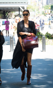 Irina Shayk completed her ensemble with brown knee-high boots.