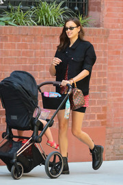 Irina Shayk was spotted out in New York City wearing a black Levi's denim jacket over a mini dress and bike shorts.