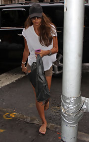 Irina paired her khaki shorts and basic white t-shirt with a leather shoulder bag.