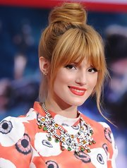 Bella Thorne looked totally casual and cool with a twisted top not and wispy bangs.