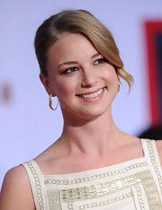 Emily VanCamp looked sleek and sophisticated on the red carpet with this slicked back updo with a face-framing curl.