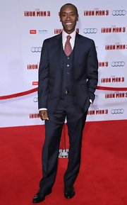 Don Cheadle looked dapper as ever in this three-piece navy suit.