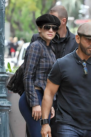 Jennifer went incognito in a cap and a pair of stylish gold-trimmed aviator shades.
