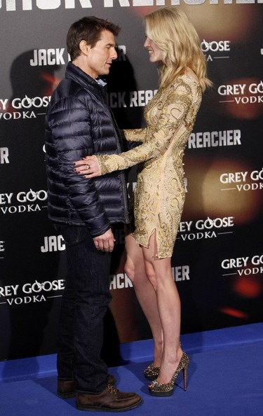"Rosamund Pink attended the premiere of ""Jack Reacher"" in a pair of gold, rhinestone-covered, peep-toe pumps."
