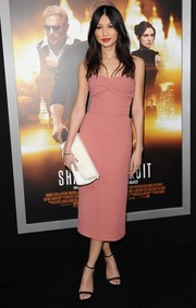 Gemma Chan's white Burberry Petal clutch and strapless dress were a flawless pairing.